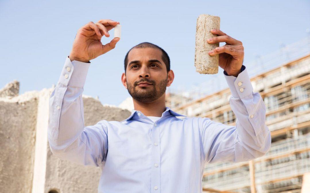 Professor Gaurav Sant holds concrete samples