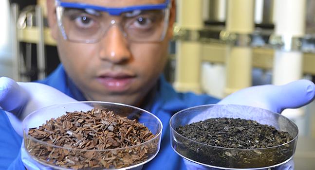 Professor Mohanty holding two soil samples